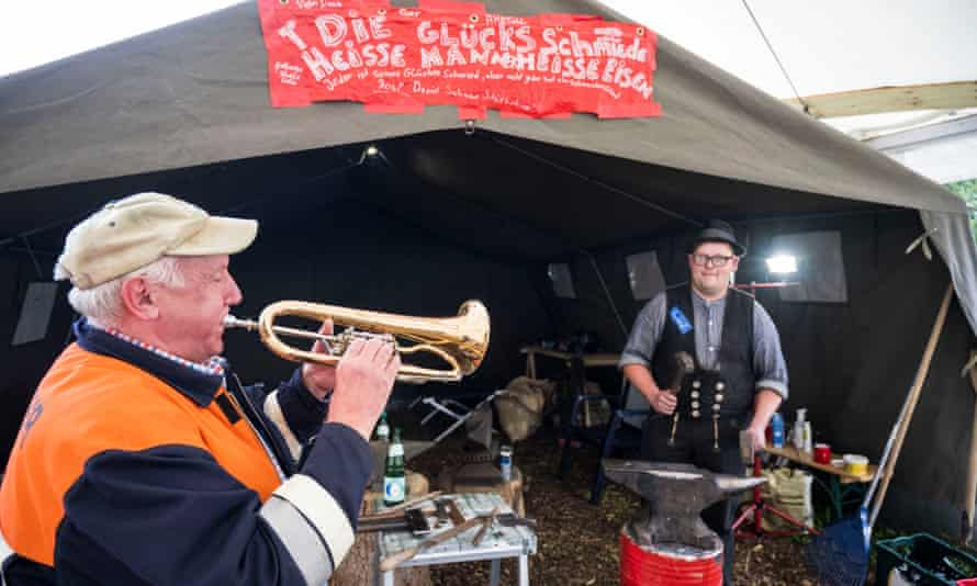 Musicians outside tent