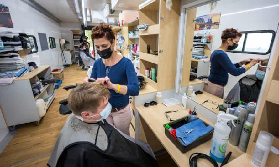 Silke Wolf and the other Barber Angels cut the hair of residents and volunteers for free