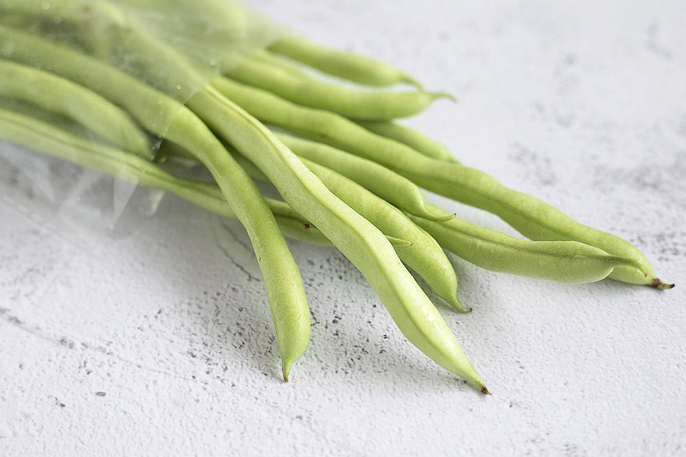 Blanch the French beans to retain a nice snap.