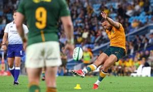 Australia's Quade Cooper kicks the ball for goal