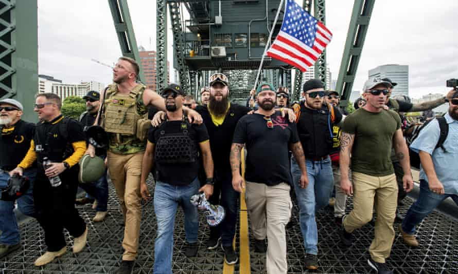 Members of the Proud Boys and other rightwing demonstrators march in Portland, Oregon in August, 2019
