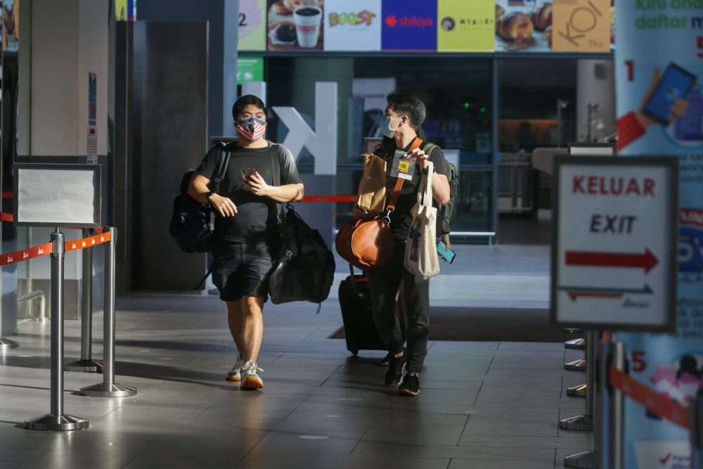 Travellers to Langkawi are pictured arriving at KLIA2, Sepang September 16, 2021. — Picture by Ahmad Zamzahuri