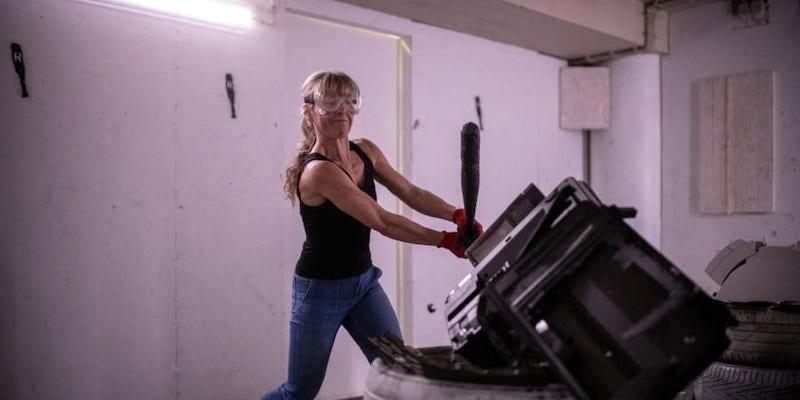 Finland's Sanna Sulin, 50, smashes items in the rage room 'Raivomoo' on September 14, 2021 in Helsinki. — ETX Studio pic