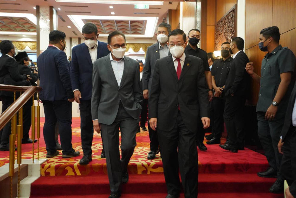 Pakatan Harapan chairman and PKR president Datuk Seri Anwar Ibrahim and DAP secretary-general Lim Guan Eng  after the official signing ceremony presided by Prime Minister Datuk Seri Ismail Sabri Yaakob in Parliament September 13, 2021. — Picture f