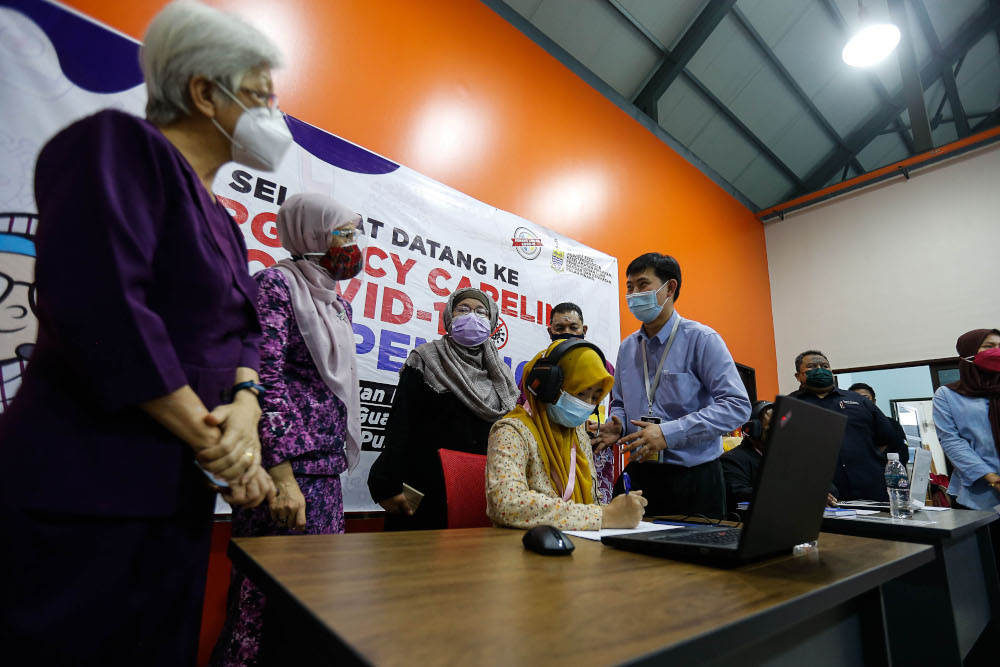 Penang state exco Norlela Ariffin (third right) and Permatang Pauh MP Nurul Izzah Anwar along with other VIPs looking at the call centre operating procedure during the launch of the Covid-19 Emergency Careline at Dewan Pintar, Guar Perahu, September 9, 2021. — Picture by Sayuti Zainudin