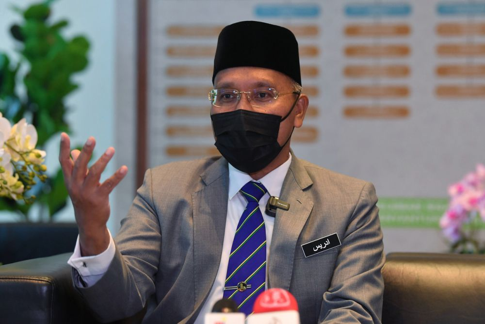 File photo of minister in the Prime Minister's Department (Religious Affairs) Idris Ahmad speaking to reporters at Putrajaya September 1, 2021. — Bernama pic
