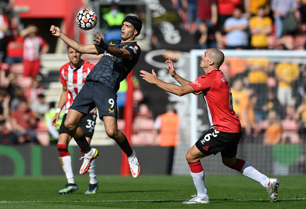 Southampton's Spanish midfielder Oriol Romeu (right) vies with Wolverhampton Wanderers' Mexican striker Raul Jimenez during the English Premier League football match at St Mary's Stadium in Southampton, September 26, 2021. — AFP pic