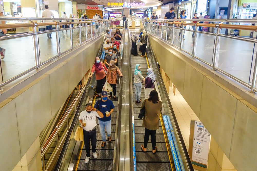 Visitors throng a shopping mall in Kuala Lumpur during Phase Two of the National Recovery Plan on September 10, 2021. — Picture by Shafwan Zaidon