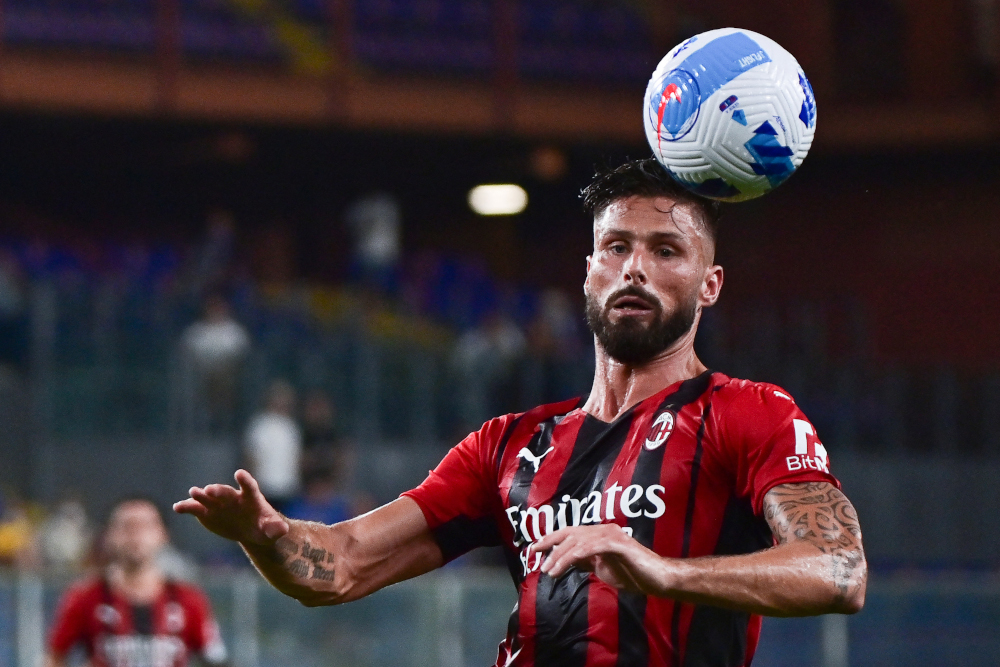 AC Milan's French forward Olivier Giroud heads the ball during the Italian Serie A football match between Sampdoria and AC Milan at the Luigi Ferraris stadium in Genova, August 23, 2021. — AFP pic