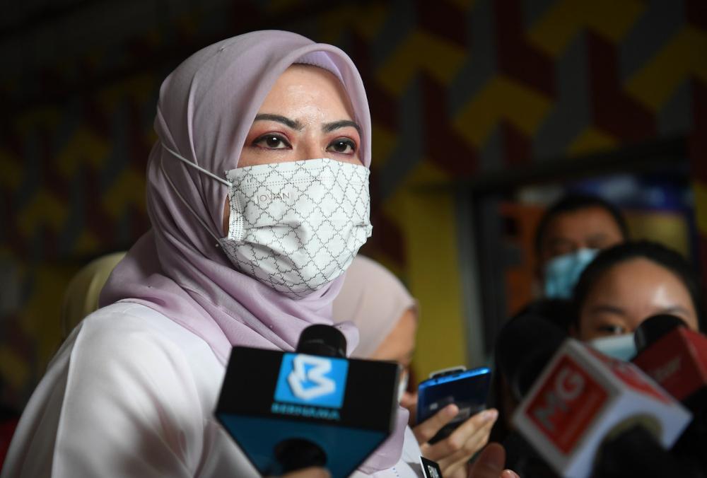 Women, Family and Community Development Minister Datuk Seri Rina Mohd Harun speaks to the media after visiting the family of robbery victim Siti Nur Azizah Syafriadi at the People's Housing Project in Beringin, Kuala Lumpur, September 2, 2021. — Berna