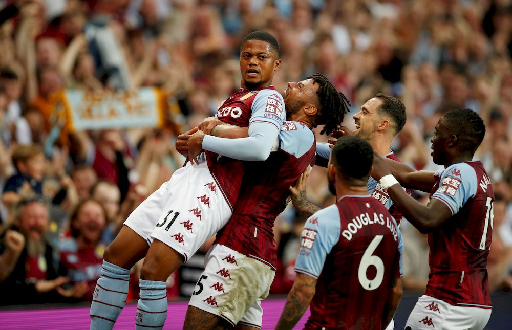 Aston Villa's Leon Bailey and Tyrone Mings celebrate after Everton's Lucas Digne scores an own goal and Aston Villa's second in Villa Park, Birmingham, September 18, 2021. — Action Images via Reuters