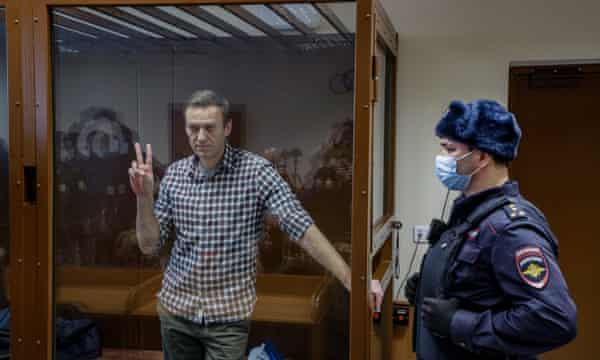 Alexei Navalny inside a glass cage
