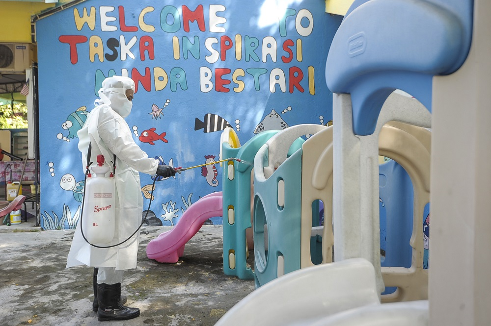 File picture of a staff member disinfecting the playground area of a childcare centre in Kajang June 9, 2020 — Picture by Shafwan Zaidon