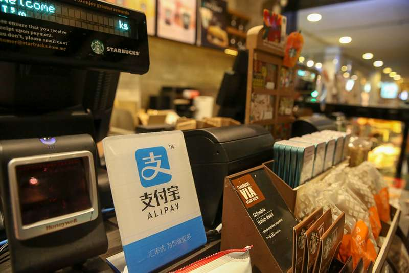 Alipay — with more than one billion users in China and other Asian nations including India — was told to spinoff its profitable micro loan business. — Picture by Choo Choy May