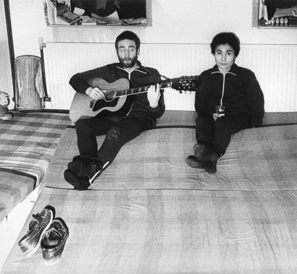 John Lennon playing guitar beside his wife Yoko Ono, January 26, 1970 in Herred, Jutland, Denmark. — AFP pic