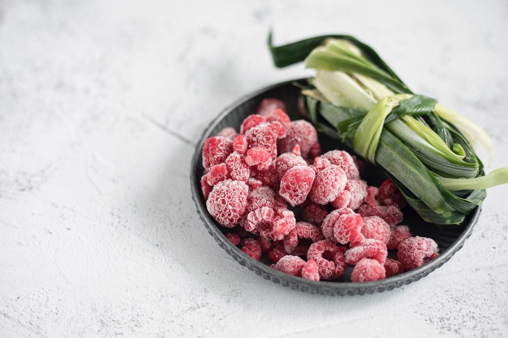 Frozen raspberries and pandan leaves.
