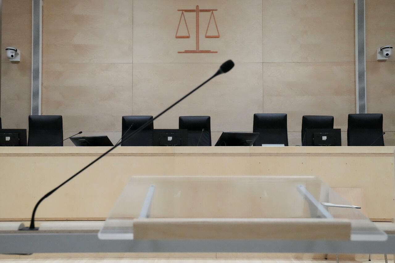The desk in the courtroom specially built for the Paris attacks trial pictured on September 2, 2021, at the court house in Paris.