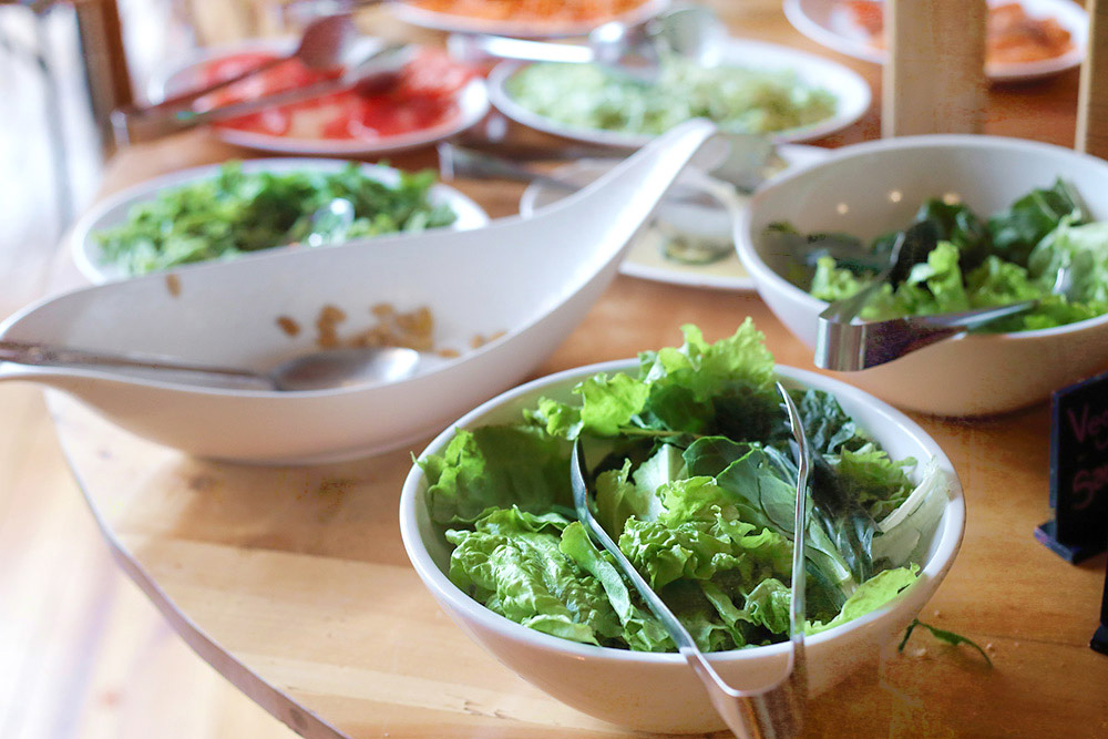 The breakfast buffet table is a great place to prepare your breakfast burritos... and even sneak some greens in!