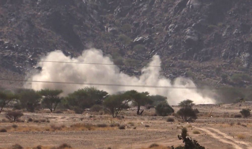 A grab from an AFPTV video shows smoke billowing while Yemeni pro-government fighters fire at positions of the Iran-backed Houthi militia in the strategic city of Marib. (File/AFP)