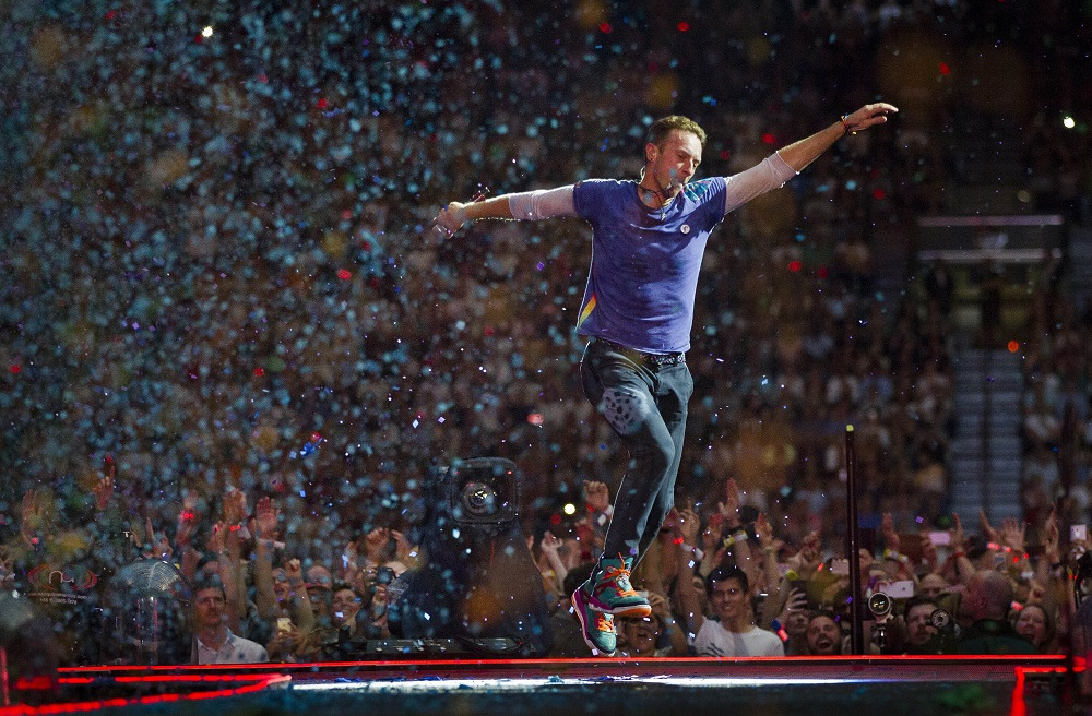 English singer-songwriter Chris Martin, frontman of British rock band Coldplay, performs on stage at the ArenA Stadium in Amsterdam on June 23, 2016, during a concert presenting the band's latest album 'A Head Full of Dreams.' — AFP pic
