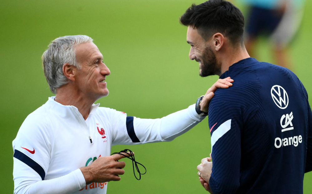 France's head coach Didier Deschamps speaks with Hugo Lloris during a training session at the Olympic stadium in Turin, October 8, 2021 two days prior to the Uefa Nations League final football match between Spain and France. — AFP pic