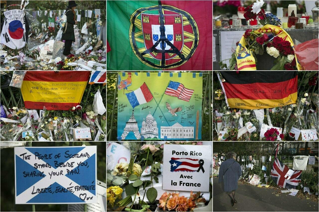"""A combination of pictures from November and December 2015 shows foreign tributes at a makeshift memorial near the Bataclan concert hall in tribute to the victims of November 13 terror attacks in Paris. (From top L) A flag of South Korea, a flag of Portugal, a Romania scarf, a flag of Spain, a child's drawing with the national flag of France (L) and the national flag of United States, a flag of Germany, a flag of Scotland, a placard bearing the Puerto Rico national flag and reading """"Puerto Rico with France"""", and a British Union Jack flag."""