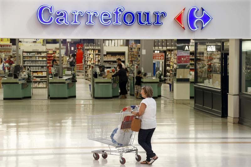 A customer at the Carrefour's Bercy hypermarket in Charenton Le Pont August 29, 2013. — Reuters pic