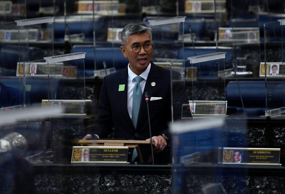 Finance Minister Datuk Seri Tengku Zafrul Abdul Aziz addresses members of Parliament in Kuala Lumpur October 11, 2021. — Bernama pic