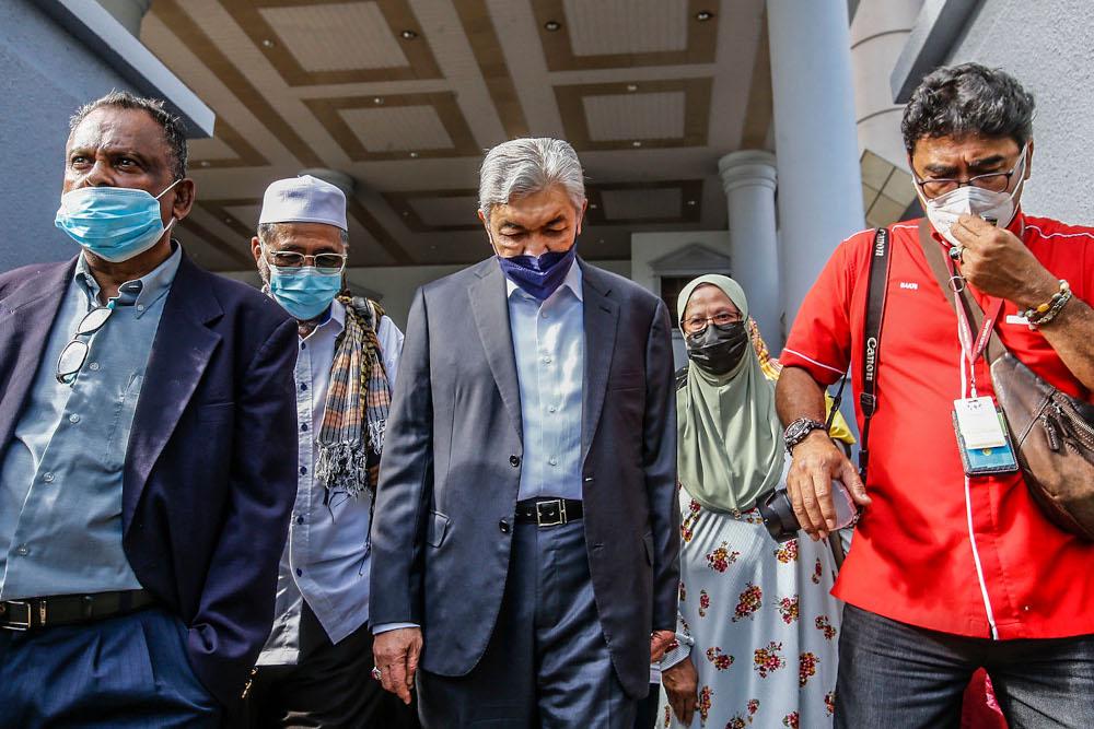 Datuk Seri Ahmad Zahid Hamidi (centre) is pictured at the Kuala Lumpur High Court October 11, 2021. ― Picture by Hari Anggara
