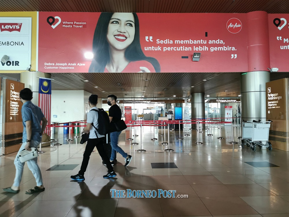 Travellers are seen at Kuching International Airport. — Picture by Roystein Emmor via Borneo Post Online