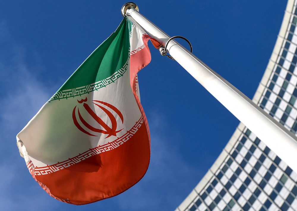 The Iranian national flag is seen outside the International Atomic Energy Agency headquarters during the agency's Board of Governors meeting in Vienna on March 1, 2021. (AFP)