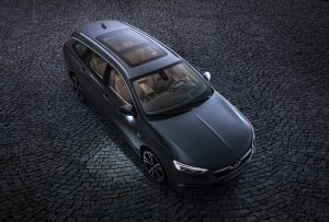 Bright outlook: The optional panorama sunroof of the Opel Insignia Sports Tourer stretches back over the heads of the rear seat passengers.