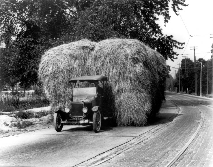 The Model TT (truck) was first sold in 1908. Although no verified hauling specifications are known, this one is pictured loaded with 8,000 pounds of hay. It was probably driving well below the Model Ts top speed of 40 mph.