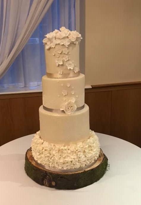 Bake Yorkshire 4 tier wedding cake ivory flowers lace ruffles glitter sparkle