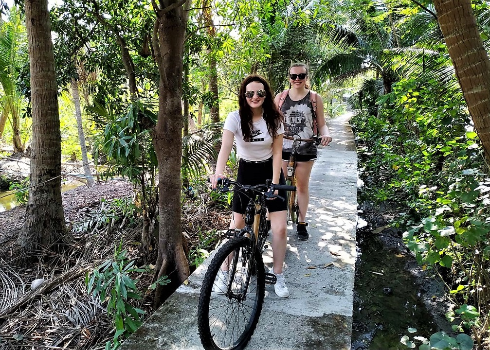 Two guests enjoying themselves during a bicycle tour