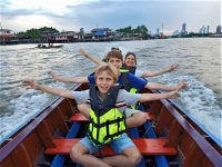 Family in longtail boat in Bangkok