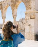 woman-taking-pictures-of-ruins-2087391