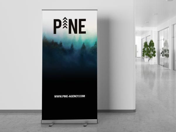 <span>Pine Agency</span><i>→</i>