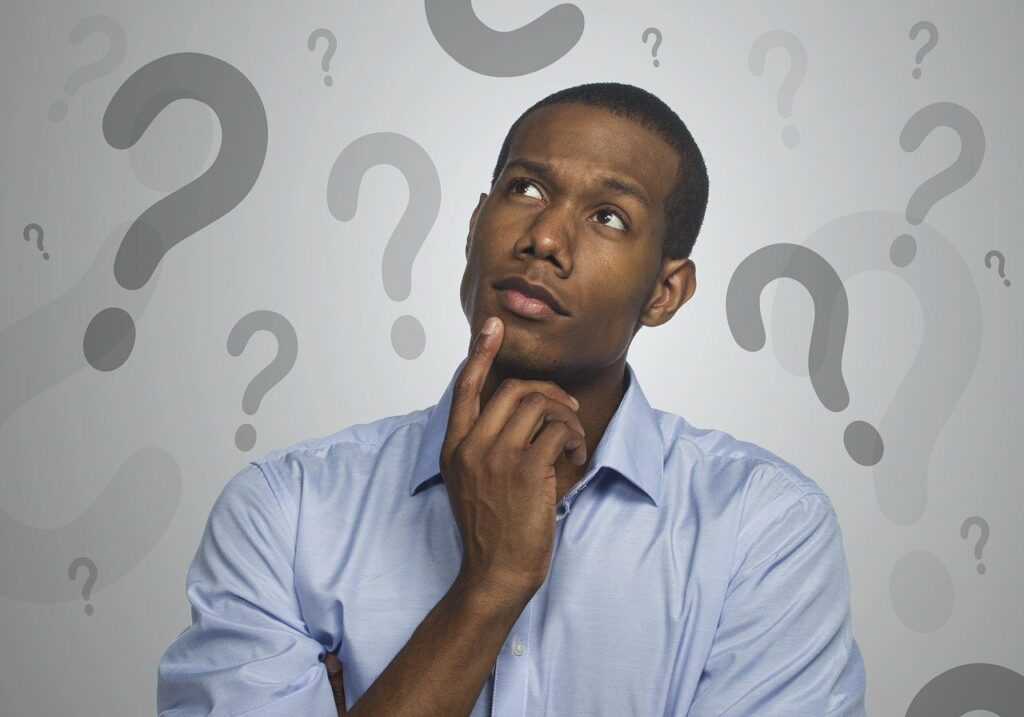 man thinking with questions marks