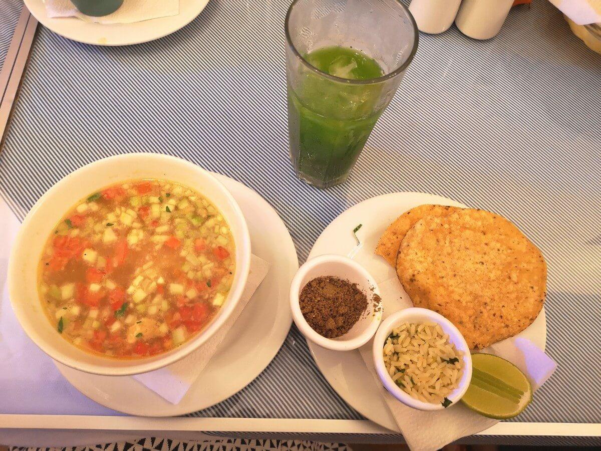 green chaya drink with traditional yucatan food