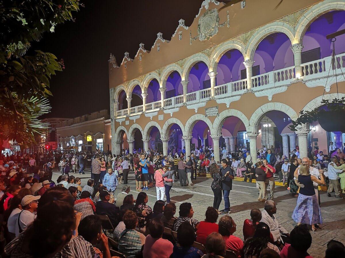 People dancing on weekly street festival in Merida