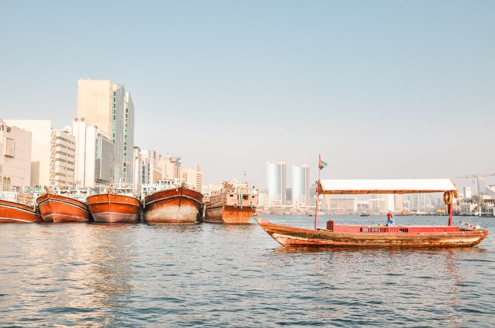 Crossing Cross Dubai Creek with Abra traditional arabic boat