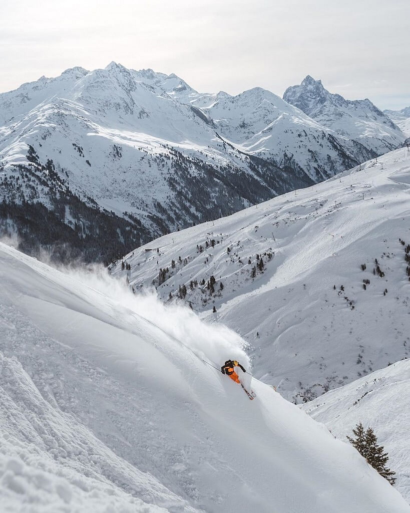 Skiing down the slope in St. Anton Alps