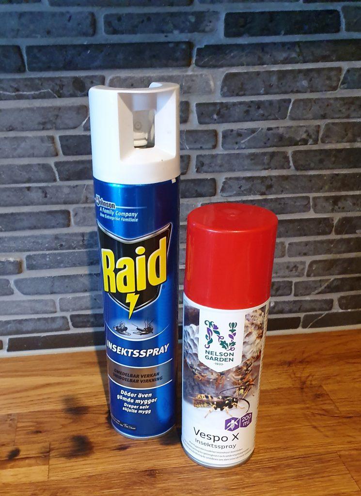 Två flaskor insektspray för ohyra i köket och inomhus