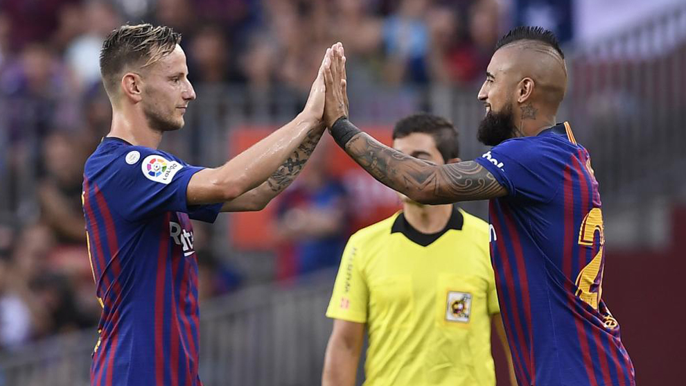 Ivan Rakitic and Arturo Vidal // AFP