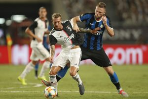 Milan Skriniar battles for the ball with Federico Bernardeschi of Juventus during the International Champions Cup match between Juventus and FC Internazionale / GETTY IMAGES ASIAPAC