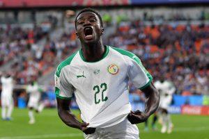 Moussa Wagué celebrating a goal for his national team, Senegal / DAN MULLAN/GETTY IMAGES EUROPE