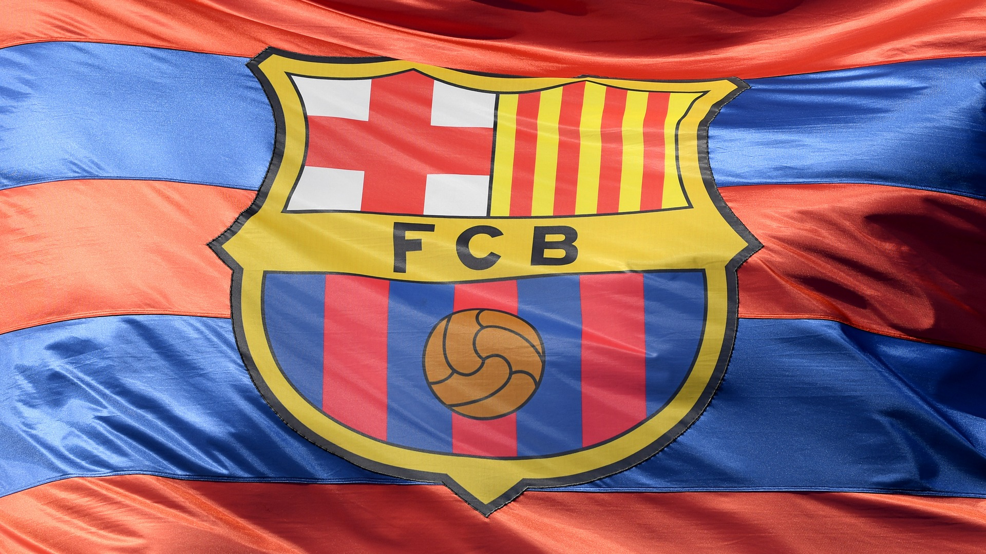 FC Barcelona's logo, on a flag / Creator: Mike Hewitt | Credit: Getty Images