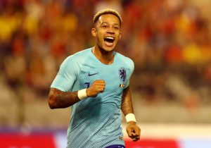 Memphis Depay, celebrates during an international friendly for his native Netherlands / DEAN MOUHTAROPOULOS/GETTY IMAGES EUROPE