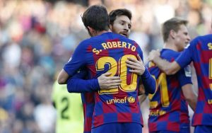 Roberto with Lionel Messi/ FC BARCELONA